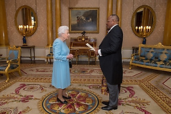The High Commissioner of Cameroon Albert Fotabong Njoteh presents credentials to Queen Elizabeth II during a private audience at Buckingham Palace, London.
