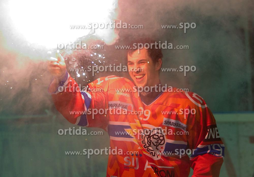 Aleksander Magovac of Acroni Jesenice celebrates after winning the ice-hockey match between HK Acroni Jesenice and HDD Tilia Olimpija in fourth game of Final at Slovenian National League, on April 8, 2011 at Arena Podmezakla, Jesenice, Slovenia. Jesenice defeated Olimpija 4-2 and became Slovenian National Champion 2010-2011. (Photo by Vid Ponikvar / Sportida)