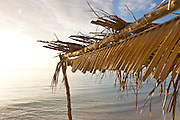 Sun shelter made out of coconut palm fronds at Oarsman's Bay Lodge, on Nacula Island. Nacula is part of the Yasawa Islands, on the western side of Fiji.