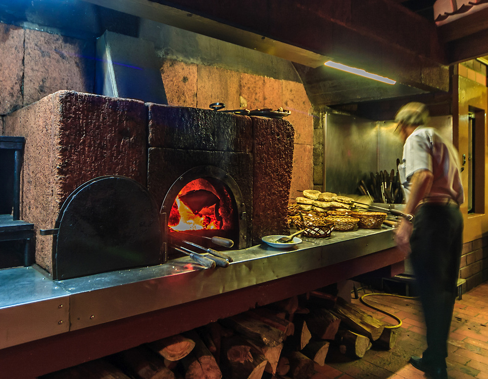 Bread baker in Madeira, Portugal. The traditional way of making bread in fire oven is still used in some small restaurant bakeries.