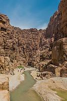 Wadi Mujib, Jordan - May 9, 2013: people waking in the canyon wadi mujib in Jordan middle east on may 9, 2013