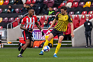 Watford defender Craig Cathcart (#15) shields the ball from Brentford Forward Ivan Toney (#17) during the EFL Sky Bet Championship match between Brentford and Watford at Brentford Community Stadium, Brentford, England on 1 May 2021.