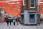 Red lanterns ready for Chinese New Year at Chinatown as the national coronavirus lockdown three continues on 5th March 2021 in London, United Kingdom. With the roadmap for coming out of the lockdown has been laid out, this nationwide lockdown continues to advise all citizens to follow the message to stay at home, protect the NHS and save lives, and the streets of the capital are quiet and empty of normal numbers of people.