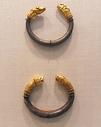 Silver bracelet with gold calf's head finial made from Gold, Silver. Greek Classical late 6th-5th century B.C.