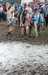 © Licensed to London News Pictures. 27/08/2011. Reading, UK. Heavy mud on Day two of Reading Festival 2011 in Reading, Berkshire today (27/08/2011). Photo credit: Ben Cawthra/LNP