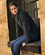 """2/14/06 -- Joliet, IL, U.S.A<br /> Sarah Wayne Callies (Dr. Sara Tancredi) takes a break from filming at the former prison in Joliet that has been transformed into  """"Fox River State Penitentiary"""" for last  fall's hit television program """"Prison Break"""" on Fox.  <br /> <br /> Photo by John Zich, USA TODAY contract photographer"""