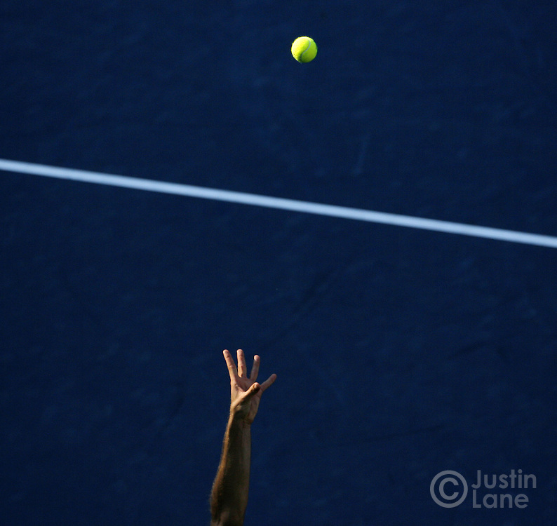 The hand of tennis player Tommy Haas tosses the ball during the 2007 US Open tennis tournament.