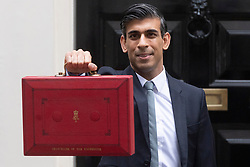 © Licensed to London News Pictures. 27/10/2021. London, UK. RISHI SUNAK the Chancellor of the Exchequer leaves No.11 Downing Street to present The Budget at The House of Commons. Photo credit: London News Pictures