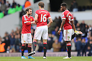 Juan Mata of Manchester United (l) talks to Michael Carrick of Manchester United and Timothy Fosu-Mensah of Manchester United before the 2nd half begins. Barclays Premier league match, Tottenham Hotspur v Manchester Utd at White Hart Lane in London on Sunday 10th April 2016.<br /> pic by John Patrick Fletcher, Andrew Orchard sports photography.