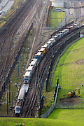 A Eurotunnel Shuttle full of artic lorries enters the Eurotunnel, Cheriton, Folkestone, Kent. United Kingdom. The Channel Tunnel is a 50.45-kilometre rail tunnel linking Folkestone, Kent, in the United Kingdom, with Coquelles, Pas-de-Calais, near Calais in northern France, beneath the English Channel.