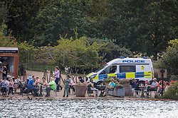 © Licensed to London News Pictures. 19/09/2020. London, UK. Members of the public enjoy the Serpentine  on a pedalo as Police patrol Hyde Park in London on the first weekend of the Rule of Six where gatherings of over six people have now been banned by the Government after a spike in coronavirus cases. Prime Minister Boris Johnson announced yesterday that the UK was heading for a second wave with the North East already under lockdown.  Photo credit: Alex Lentati/LNP