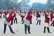 Ritu Gaur, 13, (centre) is stretching in the early hours of the morning with other pupils in front of the Jamoniya Tank Girls Hostel, near Sehore, Madhya Pradesh, India, where the Unicef India Sport For Development Project has started in 2012. Covering 313 state-run girls' hostels and 207 mixed hostels in Madhya Pradesh, the project ensures that children from Scheduled Tribes (ST) and others amongst the poorest people in India, can easily access education and be introduced to sports. Field workers from Unicef also oversee their nutrition and monitor the overall conditions of each pupil.
