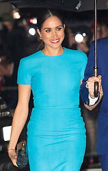 Meghan, Duchess of Sussex, wearing a Victoria Beckham turquoise blue midi pencil dress,  attends the annual Endeavour Awards at Mansion House in London on March 05, 2020.