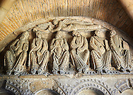 """Early Anglo Saxon sulptures of the Apostles now part of the south porch of Malmesbury Abbey, Wiltshire, England. The apostles, apart from Peter who holds a crude key, have no distinguishing feature to allow identification. Some are holding books, none have halos and some hold their heads at awkward angles. These three styles are typical of Anglo Saxon art. The two panels are 10 ft long and 4ft 6"""" high are date from the original Ango Saxon church of 705. They were probablbly built into the proch during the Norman rebuilding. The style of these sculptures is of the Roman Byzantine style and were probably sculpted by masions from Gaul.  Malmesbury Abbey, Wiltshire, England"""