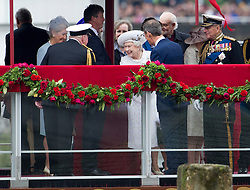 © Licensed to London News Pictures. 03/06/2012. London, UK. HRH The Queen smiling as she meets people on board Royal Barge Spirit of Chartwell during the Jubilee Pageant on the River Thames, London on June 03,2012 as part of The Diamond Jubilee celebrations. Great Britain is celebrating the 60th  anniversary of the countries Monarch HRH Queen Elizabeth II accession to the throne . Photo credit : Ben Cawthra/LNP