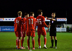 RHYL, WALES - Wednesday, November 14, 2018: Wales player appeal to referee Juri Frischer during the UEFA Under-19 Championship 2019 Qualifying Group 4 match between Wales and Scotland at Belle Vue. captain Ryan Reynolds, Dylan Levitt, Joseph Adams, Christian Norton. (Pic by Paul Greenwood/Propaganda)