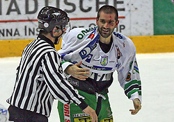 Referee and Ralph Intranuovo of Olimpija had a fight with Anze Terlikar of Jesenice in second round of ice hockey match Acroni Jesencie vs ZM Olimpija in second round of final of Slovenian National Championship,  on April 5, 2008 in Arena Podmezaklja, Jesenice, Slovenia. Acroni Jesenice won the game 6:1 and lead the series 2:0.  (Photo by Vid Ponikvar / Sportal Images)