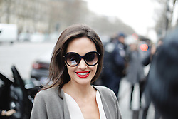 A fan proposed to signing her picture as Angelina Jolie arrives at Guerlain perfumes shop on the Champs-Elysees for 2nd day of shooting the new advertising of the french fragrance on January 30, 2018 in Paris, France. Photo by ABACAPRESS.COM