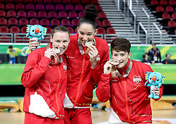 England's Stefanie Collins (right), Azania Stewart (centre) and Rachael Vanderwal (left) celebrate with their silver medals after the Women's Gold Medal Game at the Gold Coast Convention and Exhibition Centre during day ten of the 2018 Commonwealth Games in the Gold Coast, Australia.