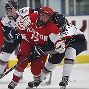 Victoria Bach, (front), Boston University, is challenged by Rebecca Lindblad, UConn, during the UConn Vs Boston University, Women's Ice Hockey game at Mark Edward Freitas Ice Forum, Storrs, Connecticut, USA. 5th December 2015. Photo Tim Clayton