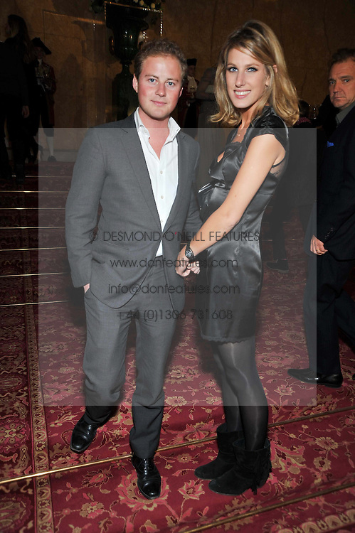 GUY PELLY and SUSANNA WARREN at a party to celebrate 300 years of Tatler magazine held at Lancaster House, London on 14th October 2009.