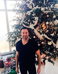 """Hugh Jackman releases a photo on Twitter with the following caption: """"""""Does this count as a white Christmas? #MerryChristmas #HappyNewYear #LifeIsWhatYouMakeIt https://t.co/mVakdYbPhj"""""""". Photo Credit: Twitter *** No USA Distribution *** For Editorial Use Only *** Not to be Published in Books or Photo Books ***  Please note: Fees charged by the agency are for the agency's services only, and do not, nor are they intended to, convey to the user any ownership of Copyright or License in the material. The agency does not claim any ownership including but not limited to Copyright or License in the attached material. By publishing this material you expressly agree to indemnify and to hold the agency and its directors, shareholders and employees harmless from any loss, claims, damages, demands, expenses (including legal fees), or any causes of action or allegation against the agency arising out of or connected in any way with publication of the material."""