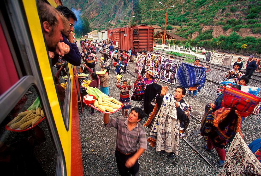 PERU, CUZCO - MACHU PICCHU TRAIN vendors at station in Urubamba Valley