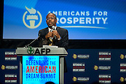 Dr. Ben Carson speaks during the Defending the American Dream Summit hosted by Americans For Prosperity at the Omni Hotel in Dallas, Texas on August 29, 2014. (Cooper Neill for The New York Times)