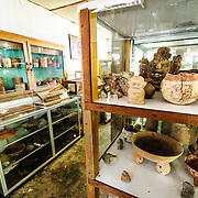 The exhibit room of the museo on Radio Peten Island. Off the western side of the island of Flores is another much smaller island known simply as Radio Peten after the radio station that has broadcast from there since 1947. There are only a handful of buildings on the island, one of which is a small, one-room museum of Maya artifacts and various radio, telephone, and other artifacts. The only way to approach the island is by boat.