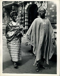 Jul. 29, 1953 - Nigerian visitors in London. For talks with Colonial Secretary: A party of Nigerians arrived in London last evening for talks with Oliver Ly Tleton on the future of the Nigerian constitution and of self government in 1956. Photo shows Mrs. Tanimowo Ogunlesi the only woman member of the party and Mr. Obafemi Awolowo the chief delegate leave their London Hotel for a sight seeing tour this morning. (Credit Image: © Keystone Press Agency/Keystone USA via ZUMAPRESS.com)