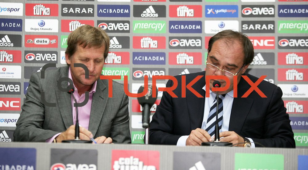 Besiktas Istanbul's soccer club new coach German Bernd Schuster (L) and Besiktas' president Yildirim Demiroren (R) attend a signing ceremony in Istanbul, Turkey on 16 June 2010. Schuster signed a two years contract with the Turkish soccer club. Photo by TURKPIX