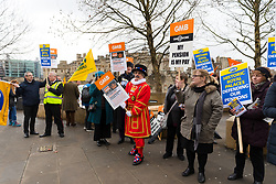 © Licensed to London News Pictures. 06/02/2019. London, UK.  An actor dressed as a Beefeater for the GMB Union joins protesters outside the Tower of London this afternoon. GMB union members working for Historic Royal Palaces (HRP) are striking today at the Tower of London over the closure of their pension scheme. Photo credit: Vickie Flores/LNP