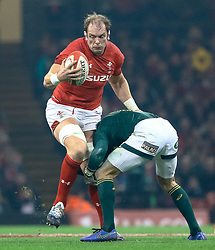 Alun Wyn Jones of Wales under pressure from Damian de Allende of South Africa<br /> <br /> Photographer Simon King/Replay Images<br /> <br /> Under Armour Series - Wales v South Africa - Saturday 24th November 2018 - Principality Stadium - Cardiff<br /> <br /> World Copyright © Replay Images . All rights reserved. info@replayimages.co.uk - http://replayimages.co.uk