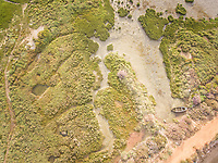Aerial view of an abandoned boat in the Formosa lagoon in Portugal.