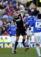 Photo: Leigh Quinnell.<br /> Leicester City v Hull FC. Coca Cola Championship. 04/03/2006. Hulls Stuart Elliott jumps with Leicesters  Joey Gudjonsson.