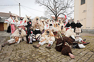Busó carnival, Mohács, Hungary. Pictured, a busó group poses for a photo beside the Serbian Orthodox church. The Busó carnival or Busójárás is inscribed on the UNESCO list of Intangible Cultural Heritage. © Rudolf Abraham