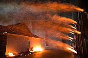 Richburg, S.C. - Fire scientists at the IBHS Research Center recreate an ember storm in the lab's large test chamber. This facility is the first in the world capable of subjecting full-scale buildings to realistic wildfire conditions.