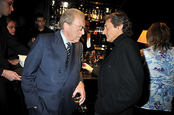 "Left to right, SIR DAVID FROST and NIGEL HAVERS at a party to promote the ""American Songbook in London"" aseries of intimate concerts featuring 1959 Broadway songs, held at Pizza on The Park, Hyde Park Corner, London on 18th March 2009."