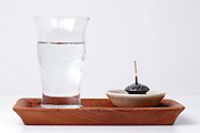 water and incense as used for a at home shrine Japan