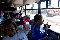 30 Oct, 2005.  New Orleans, Louisiana. Hurricane Katrina aftermath.<br /> Riding on the Gray Line bus tour for residents of the Lower 9th ward. Unlike the nearby predominantly white neighbourhoods, residents can only visit the area on special busses and are not permitted to get off the bus except at one designated location to view a 'typical' house. <br /> Photo; ©Charlie Varley/varleypix.com