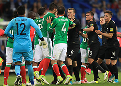 New Zealand's Chris Wood (centre right) clashes with Mexico's Nestor Araujo as tempers flare after a challenge