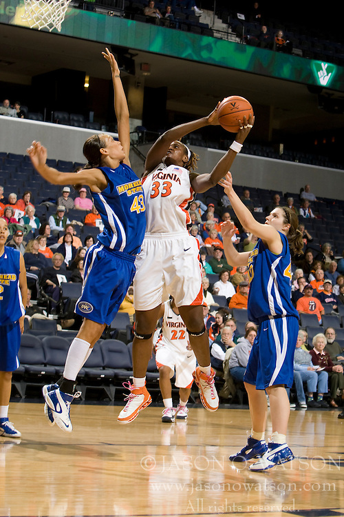 Virginia center Aisha Mohammed (33) is fouled by Morehead St. forward Brittany Pittman (43) on her way to the basket.  The Virginia Cavaliers women's basketball team defeated the Morehead State Eagles 88-43 at the John Paul Jones Arena in Charlottesville, VA on February 4, 2008.
