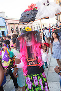 A man dressed as a skeleton bride during the Day of the Dead Festival known in spanish as Día de Muertos on October 25, 2014 in Oaxaca, Mexico.