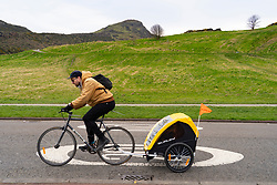 Edinburgh, Scotland, UK. 5 April, 2020. On the second Sunday of the coronavirus lockdown in the UK the public are outside taking their daily exercise. A cyclist rides through Holyrood Park.  Iain Masterton/Alamy Live News