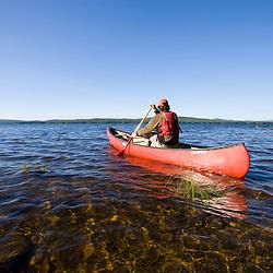 Canoeing on Maine's Brassua Lake.  Near Moosehead Lake, owned by Plum Creek. (MR)