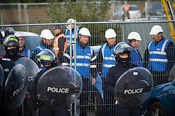 © Licensed to London News Pictures. 19/10/2011. Crays Hill, UK. Bailiffs and police wait to enter the site. Residents at Dale Farm, the UK's largest illegal traveller site being evicted today (19/10/2011) following a long dispute with Basildon Council . Travellers and activist had barricaded themselves in to the site in an attempt to prevent their eviction. Photo credit: Ben Cawthra/LNP