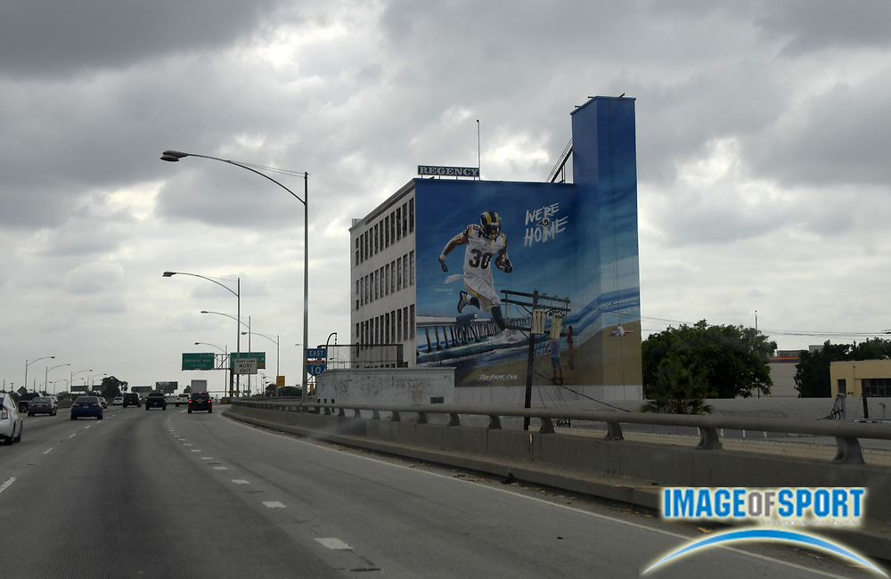 """Sep 4, 2016; Los Angeles, CA, USA; General view of billboard of Los Angeles Rams running back Todd Gurley on a building in the downtown fashion district with the words """"We're Home"""" to recognize the return of the franchise for the 2016 NFL season."""
