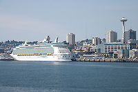 Seattle waterfront and Space Needle and a cruise ship on Puget Sound, WA, USA