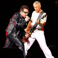 MINNEAPOLIS, MN - JULY 23:  Bono and Bassist Adam Clayton of U2, perform at TCF Bank Stadium on July 23, 2011 in Minneapolis, Minnesota. (Photo by Adam Bettcher/Getty Images) *** Local Caption *** Bono, Adam Clayton