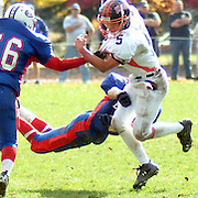 "October 20, 2007 -- TOPSHAM, Maine. Brunswick Junior Quarterback Robbie Basquez evades two Mt. Ararat tacklers in Saturday's win in Topsham. Brunswick won the ""Battle of the Bridge"" 26-15. Photo by Roger S. Duncan."